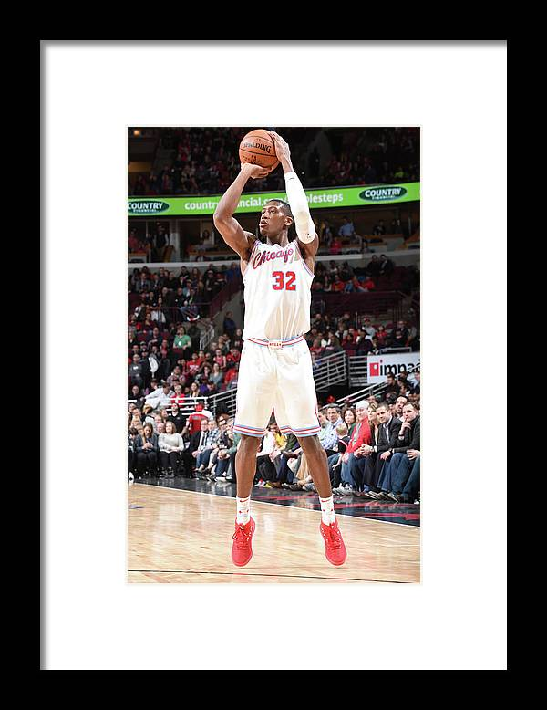 Chicago Bulls Framed Print featuring the photograph Kris Dunn by Randy Belice