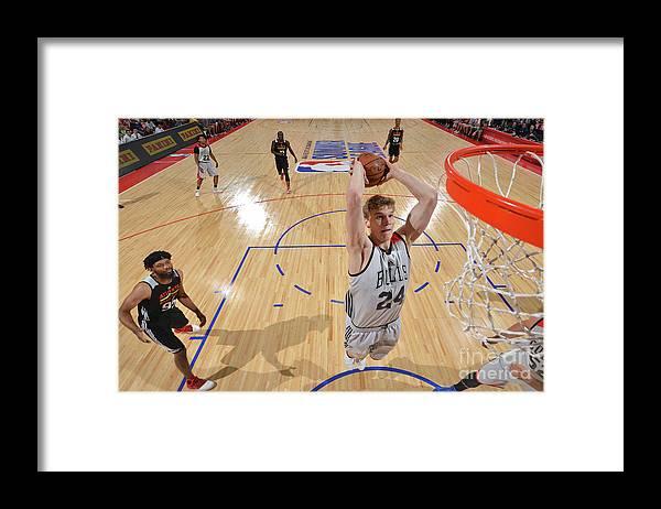 Chicago Bulls Framed Print featuring the photograph Lauri Markkanen by David Dow