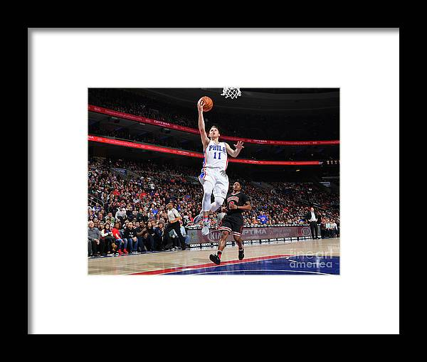 Nba Pro Basketball Framed Print featuring the photograph Nik Stauskas by Jesse D. Garrabrant