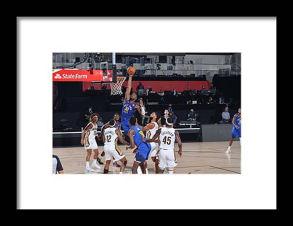 Nba Pro Basketball Framed Print featuring the photograph Noah Vonleh by Garrett Ellwood