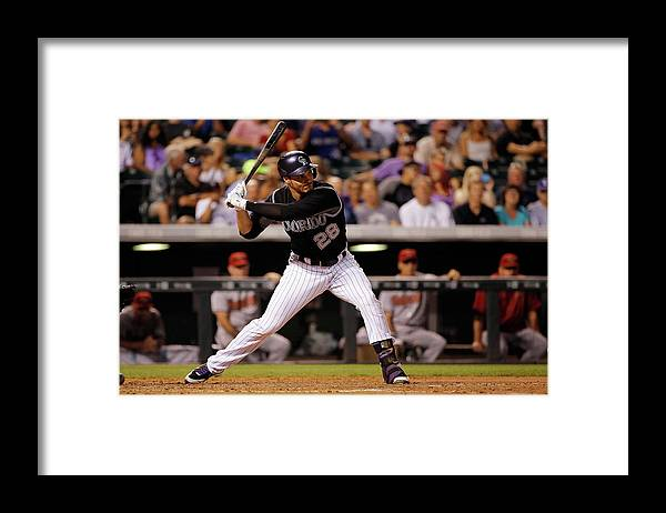 Nolan Arenado Framed Print featuring the photograph Nolan Arenado by Doug Pensinger