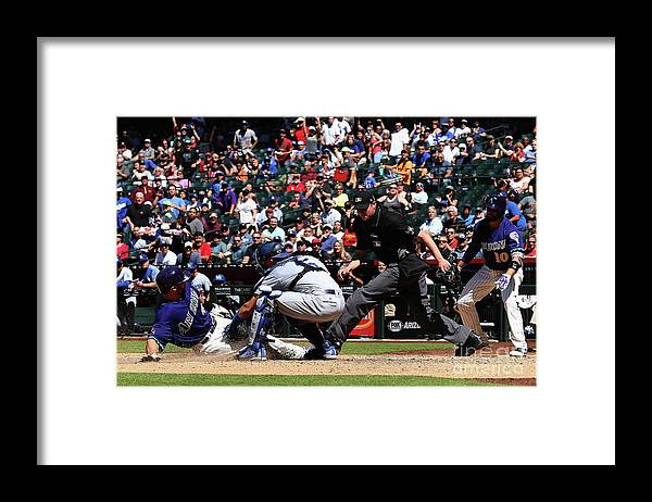 Baseball Catcher Framed Print featuring the photograph Paul Goldschmidt and Austin Barnes by Christian Petersen