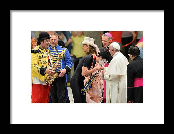 State Of The Vatican City Framed Print featuring the photograph Pope Francis celebrates the Jubilee of the 'World of Travelling Shows' by NurPhoto