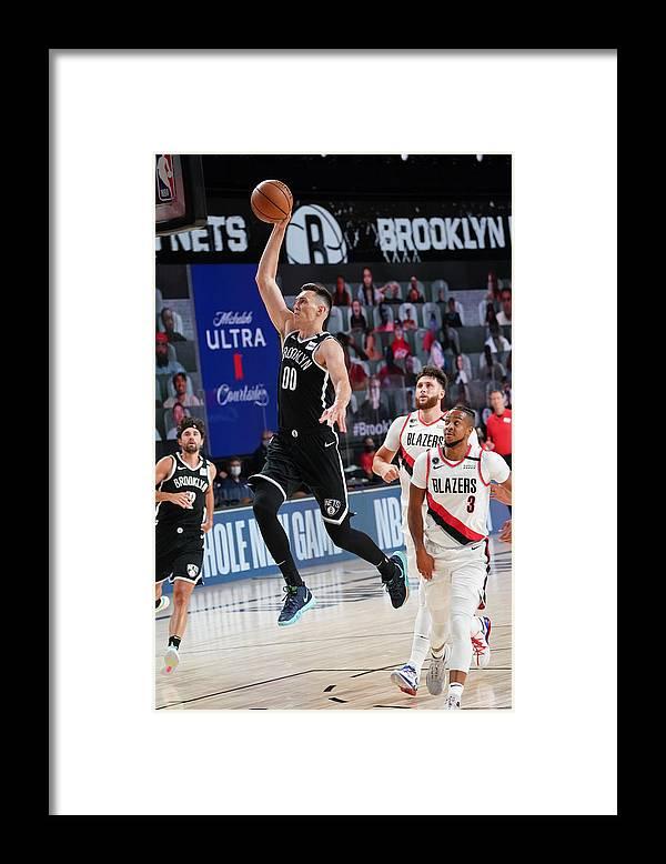 Nba Pro Basketball Framed Print featuring the photograph Portland Trail Blazers v Brooklyn Nets by Jesse D. Garrabrant
