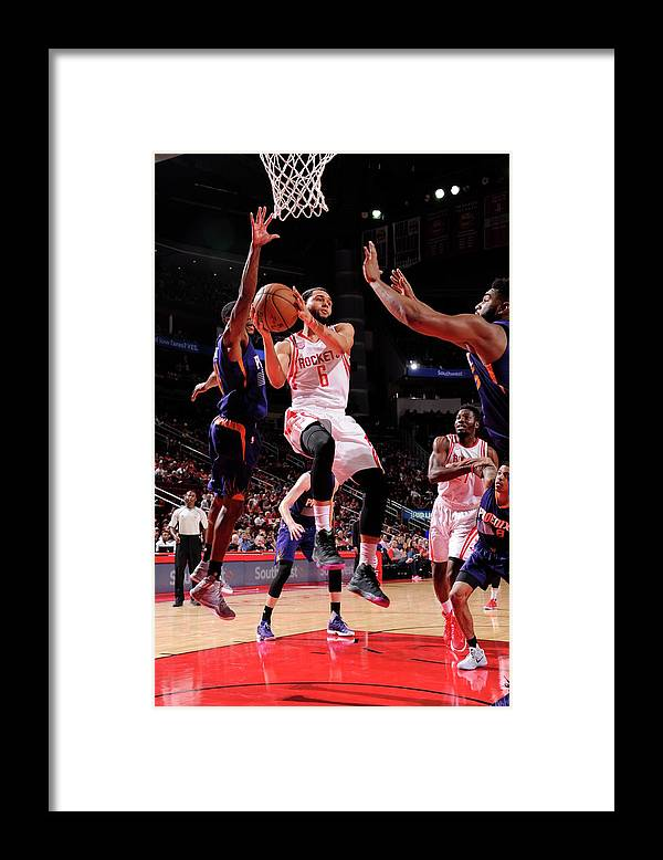 Nba Pro Basketball Framed Print featuring the photograph Tyler Ennis by Bill Baptist