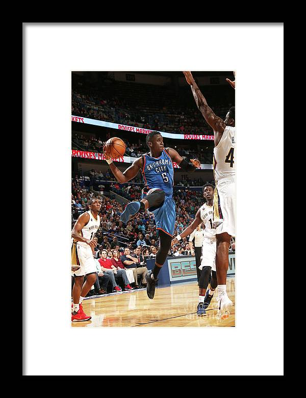 Smoothie King Center Framed Print featuring the photograph Victor Oladipo by Layne Murdoch