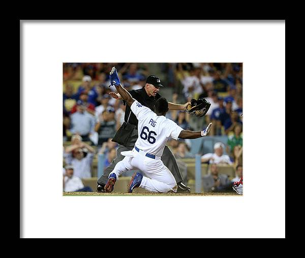 People Framed Print featuring the photograph Yasiel Puig by Stephen Dunn