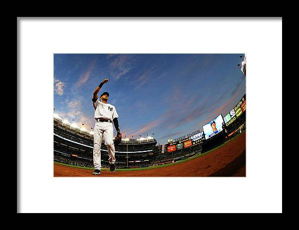 Derek Jeter Framed Print featuring the photograph Derek Jeter by Al Bello