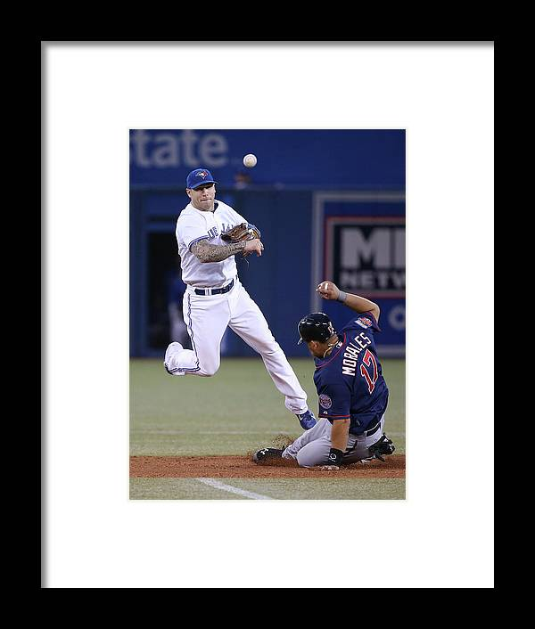 Double Play Framed Print featuring the photograph Jay Rogers by Tom Szczerbowski