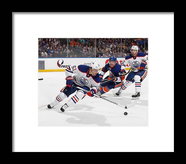 National Hockey League Framed Print featuring the photograph Edmonton Oilers v New York Islanders by Bruce Bennett