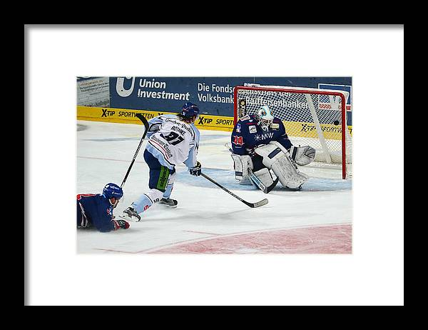 Dennis Endras Framed Print featuring the photograph Adler Mannheim v Straubing Tigers - DEL by Alex Grimm