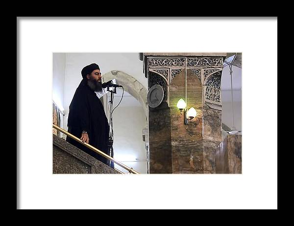 Releasing Framed Print featuring the photograph Alleged ISIL leader appears in video footage by Anadolu Agency