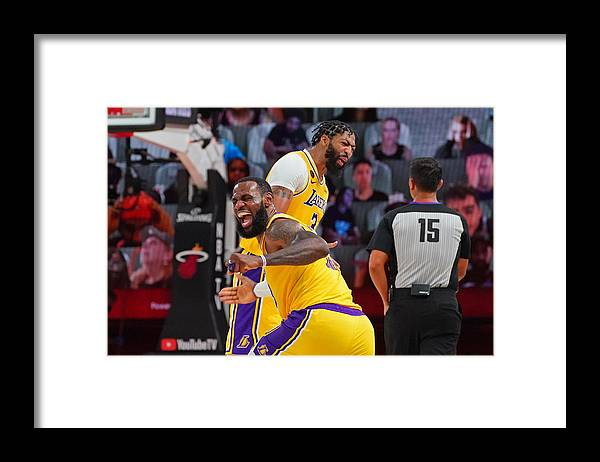 Playoffs Framed Print featuring the photograph Anthony Davis and Lebron James by Jesse D. Garrabrant