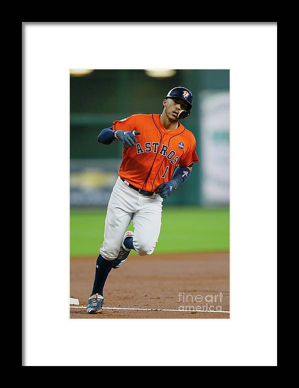 Game Two Framed Print featuring the photograph Carlos Correa by Bob Levey
