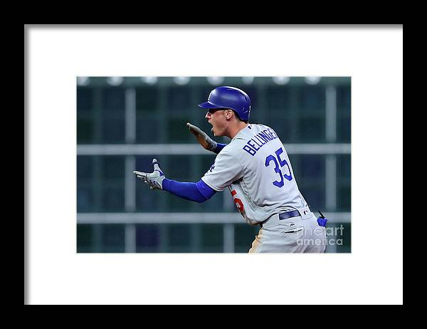 Three Quarter Length Framed Print featuring the photograph Cody Bellinger by Tom Pennington