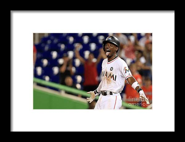 Three Quarter Length Framed Print featuring the photograph Dee Gordon by Mike Ehrmann