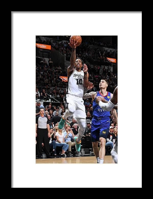 Playoffs Framed Print featuring the photograph Demar Derozan by Garrett Ellwood