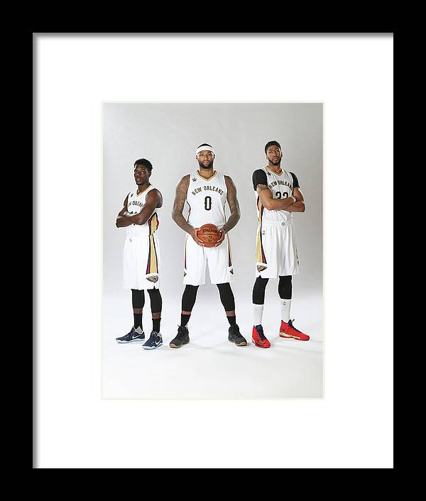 Nba Pro Basketball Framed Print featuring the photograph Demarcus Cousins, Jrue Holiday, and Anthony Davis by Layne Murdoch