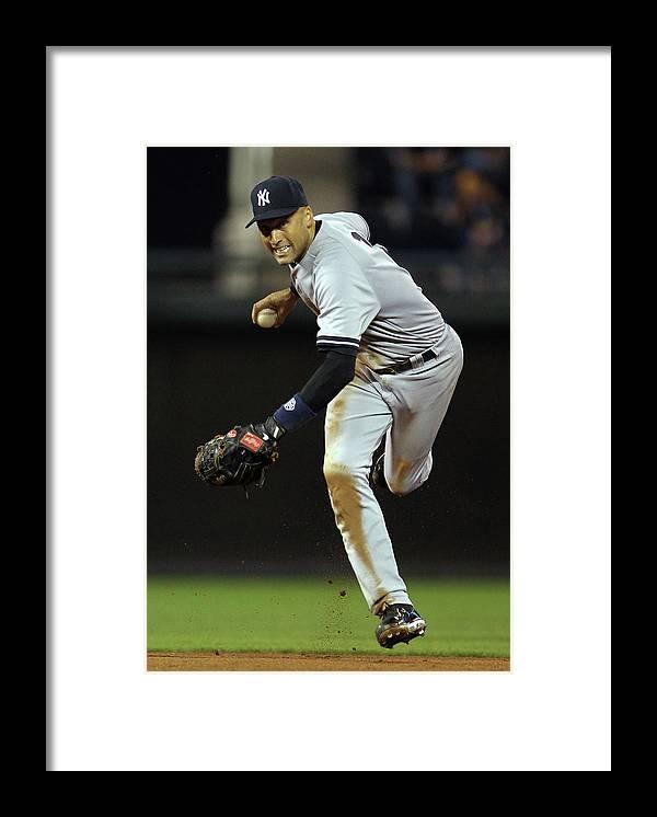Derek Jeter Framed Print featuring the photograph Derek Jeter by Jamie Squire