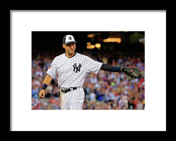 Crowd Framed Print featuring the photograph Derek Jeter by Rob Carr
