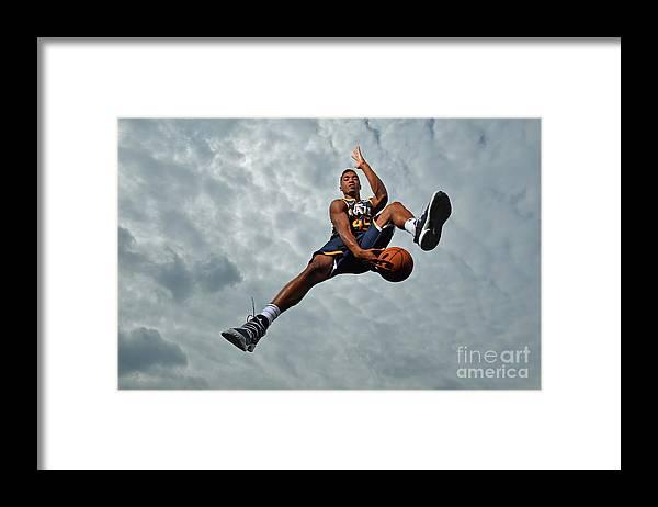 Nba Pro Basketball Framed Print featuring the photograph Donovan Mitchell by Jesse D. Garrabrant