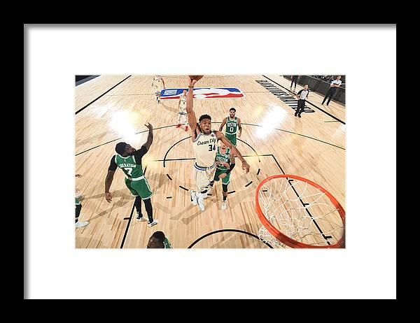 Nba Pro Basketball Framed Print featuring the photograph Giannis Antetokounmpo by Garrett Ellwood