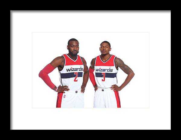 Nba Pro Basketball Framed Print featuring the photograph John Wall and Bradley Beal by Ned Dishman