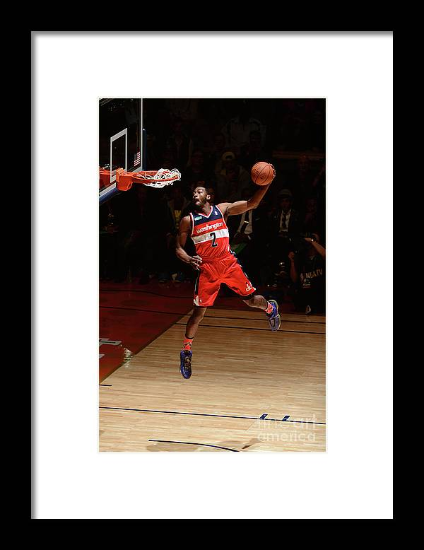 Smoothie King Center Framed Print featuring the photograph John Wall by Garrett Ellwood