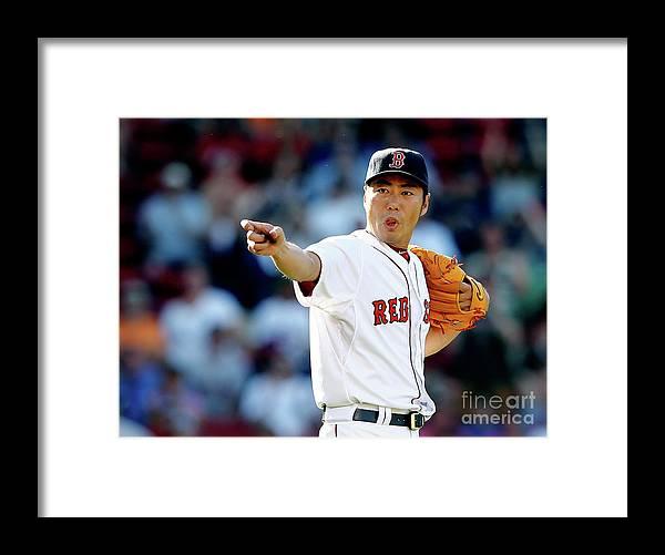 American League Baseball Framed Print featuring the photograph Koji Uehara by Jim Rogash