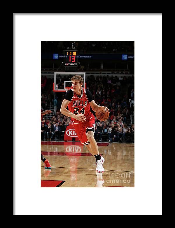 Nba Pro Basketball Framed Print featuring the photograph Lauri Markkanen by Gary Dineen