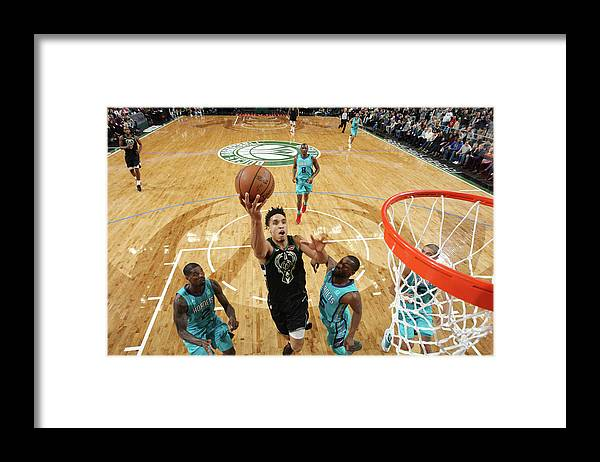 Nba Pro Basketball Framed Print featuring the photograph Malcolm Brogdon by Gary Dineen