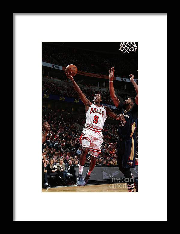 Nba Pro Basketball Framed Print featuring the photograph Rajon Rondo by Gary Dineen