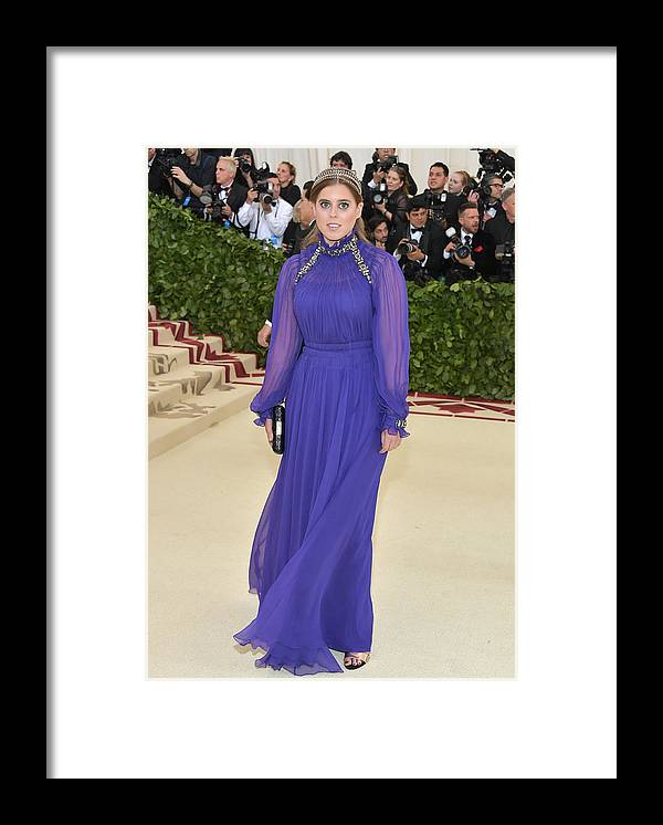 Purple Dress Framed Print featuring the photograph Heavenly Bodies: Fashion & The Catholic Imagination Costume Institute Gala - Arrivals by Neilson Barnard