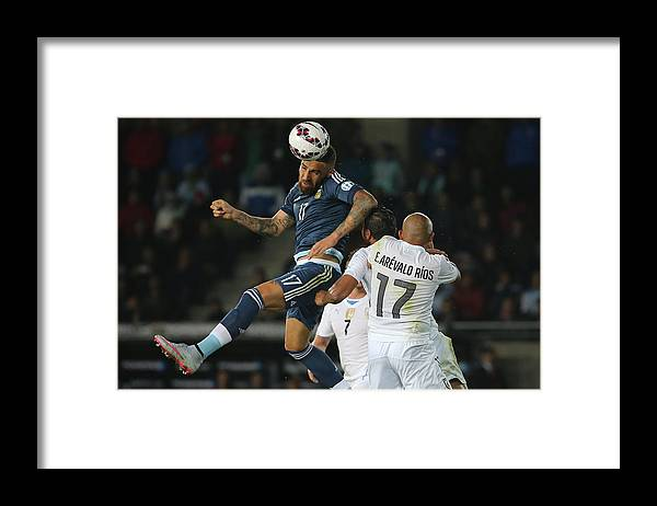 International Match Framed Print featuring the photograph Argentina v Uruguay: Group B - 2015 Copa America Chile by Raul Sifuentes
