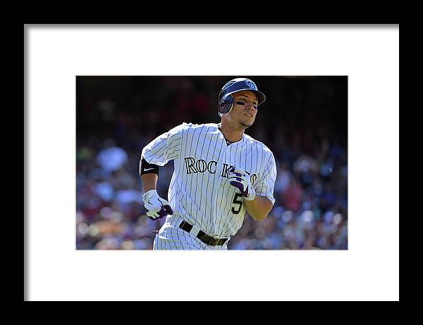 American League Baseball Framed Print featuring the photograph Carlos Gonzalez by Doug Pensinger