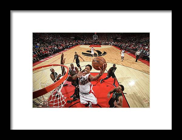 Playoffs Framed Print featuring the photograph Demar Derozan by Ron Turenne