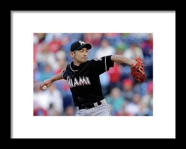 Three Quarter Length Framed Print featuring the photograph Ichiro Suzuki by Adam Hunger