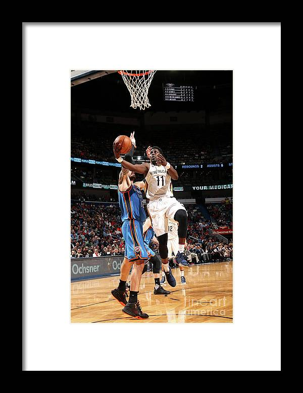 Smoothie King Center Framed Print featuring the photograph Jrue Holiday by Layne Murdoch