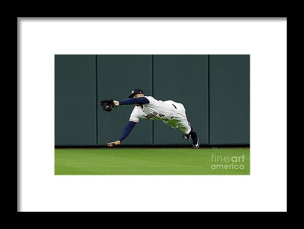 People Framed Print featuring the photograph Khris Davis And George Springer by Bob Levey