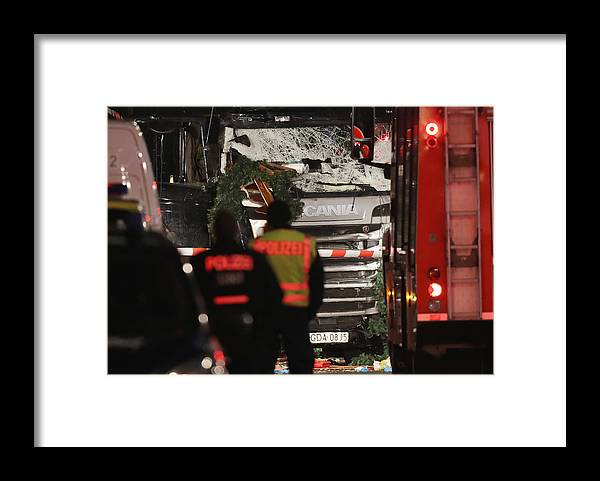Berlin Framed Print featuring the photograph Lorry Drives Through Christmas Market In Berlin by Sean Gallup