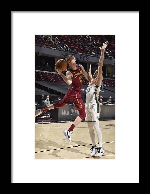 Nba Pro Basketball Framed Print featuring the photograph Milwaukee Bucks v Cleveland Cavaliers by David Liam Kyle