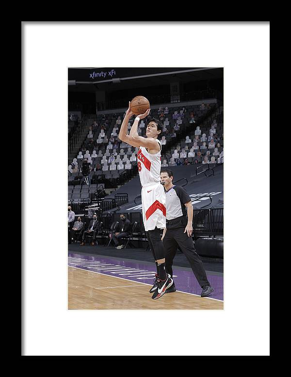 Nba Pro Basketball Framed Print featuring the photograph Toronto Raptors v Sacramento Kings by Rocky Widner
