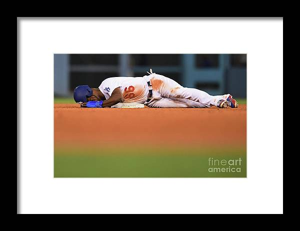Game Two Framed Print featuring the photograph Yasiel Puig by Harry How