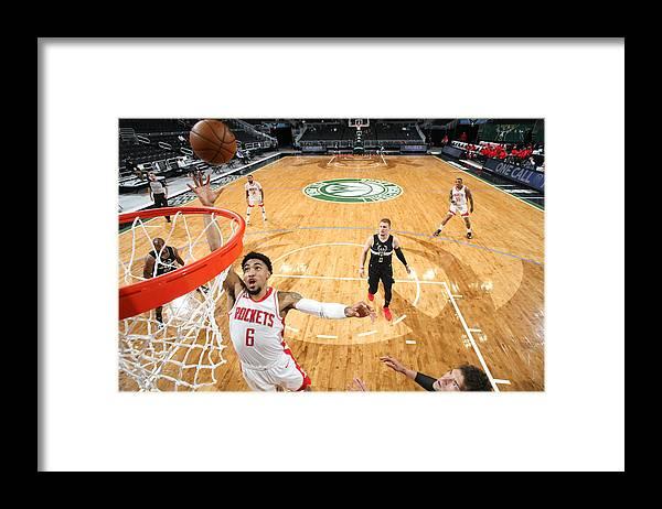 Nba Pro Basketball Framed Print featuring the photograph Houston Rockets v Milwaukee Bucks by Gary Dineen