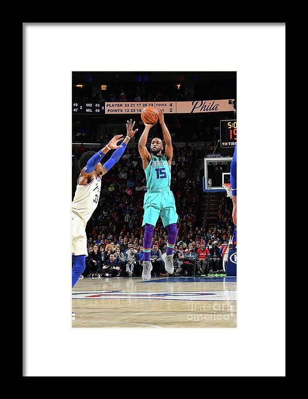 Kemba Walker Framed Print featuring the photograph Kemba Walker by Jesse D. Garrabrant