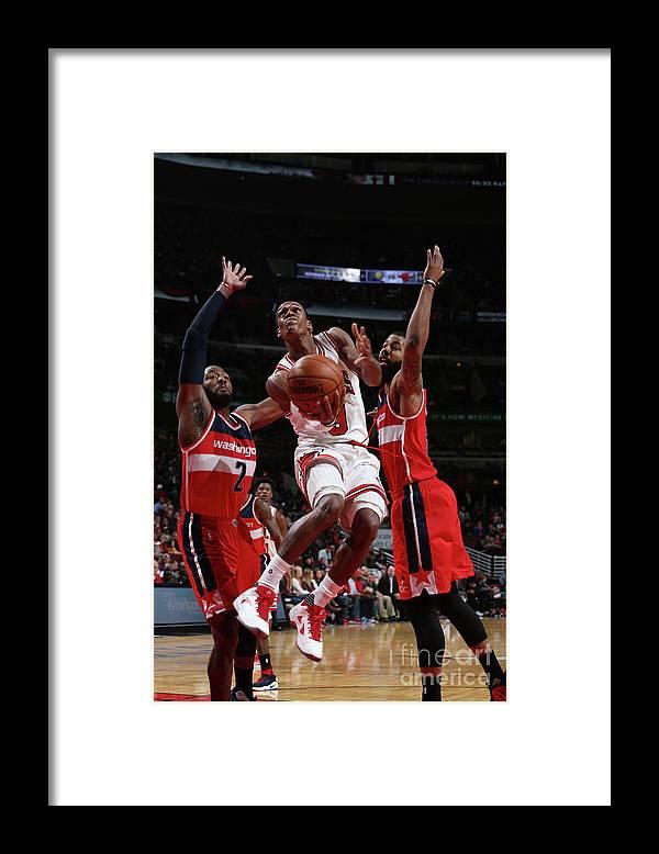 Nba Pro Basketball Framed Print featuring the photograph Rajon Rondo by Gary Dineen