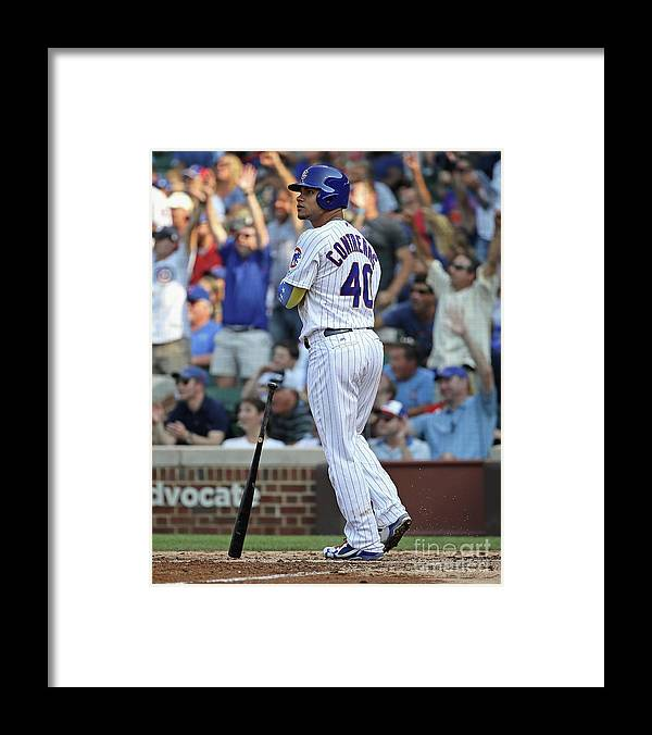 Following Framed Print featuring the photograph Willson Contreras by Jonathan Daniel