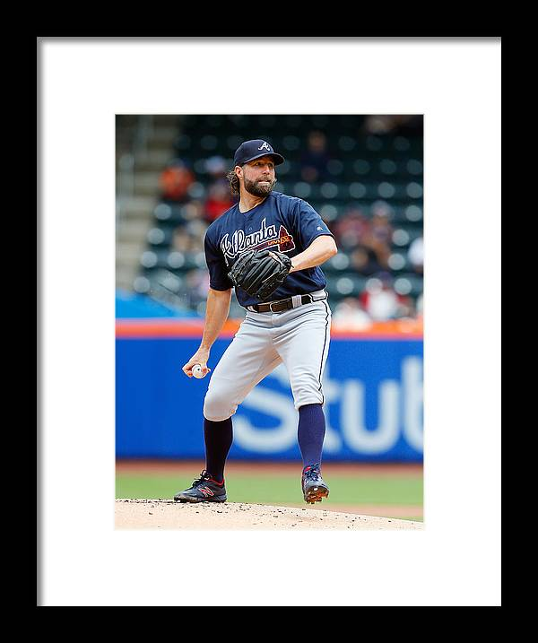 People Framed Print featuring the photograph Atlanta Braves v New York Mets by Jim McIsaac