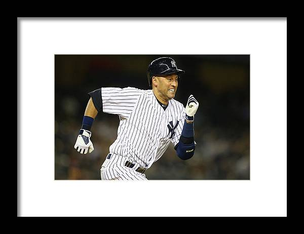 People Framed Print featuring the photograph Derek Jeter by Al Bello