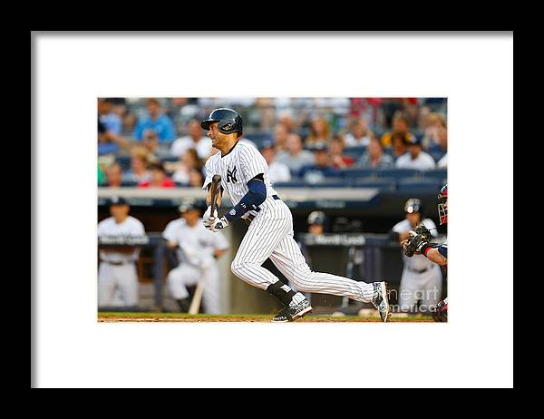 People Framed Print featuring the photograph Derek Jeter by Mike Stobe